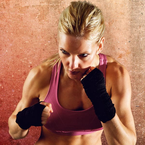 Mixed Martial Arts Lessons for Adults in _Williamsburg_ _VA_ - Lady Kickboxing Focused Background