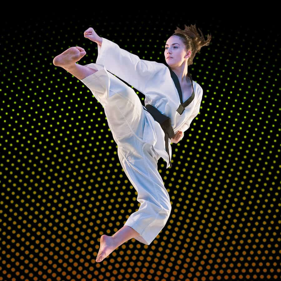 Martial Arts Lessons for Adults in _Williamsburg_ _VA_ - Girl Black Belt Jumping High Kick