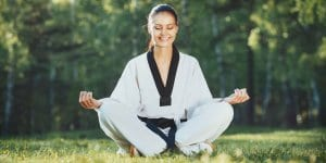 Martial Arts Lessons for Adults in _Williamsburg_ _VA_ - Happy Woman Meditated Sitting Background